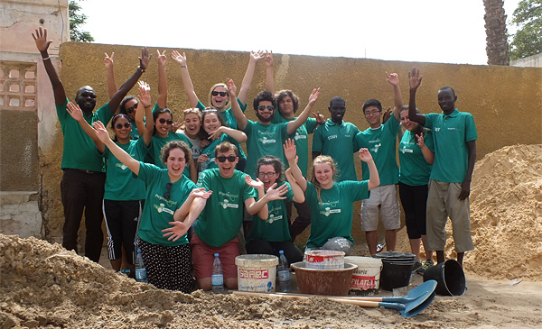 A group of High School Special volunteers and local Projects Abroad staff in Senegal